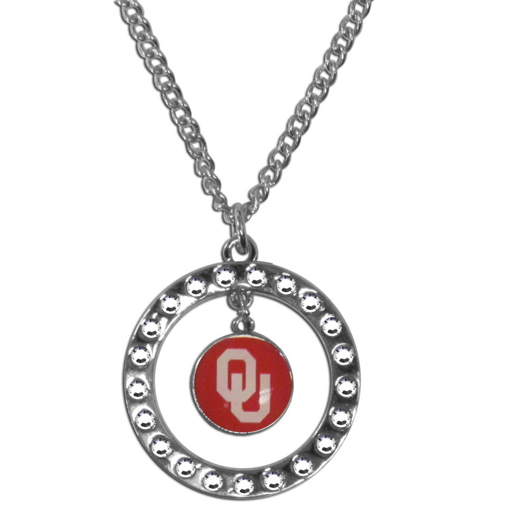 Oklahoma Sooners Rhinestone Hoop Necklace - Our Oklahoma Sooners rhinestone hoop necklace comes on an 18 inch chain and features a hoop covered in rhinestones with a high polish chrome finish and a team logo dangling in the center.