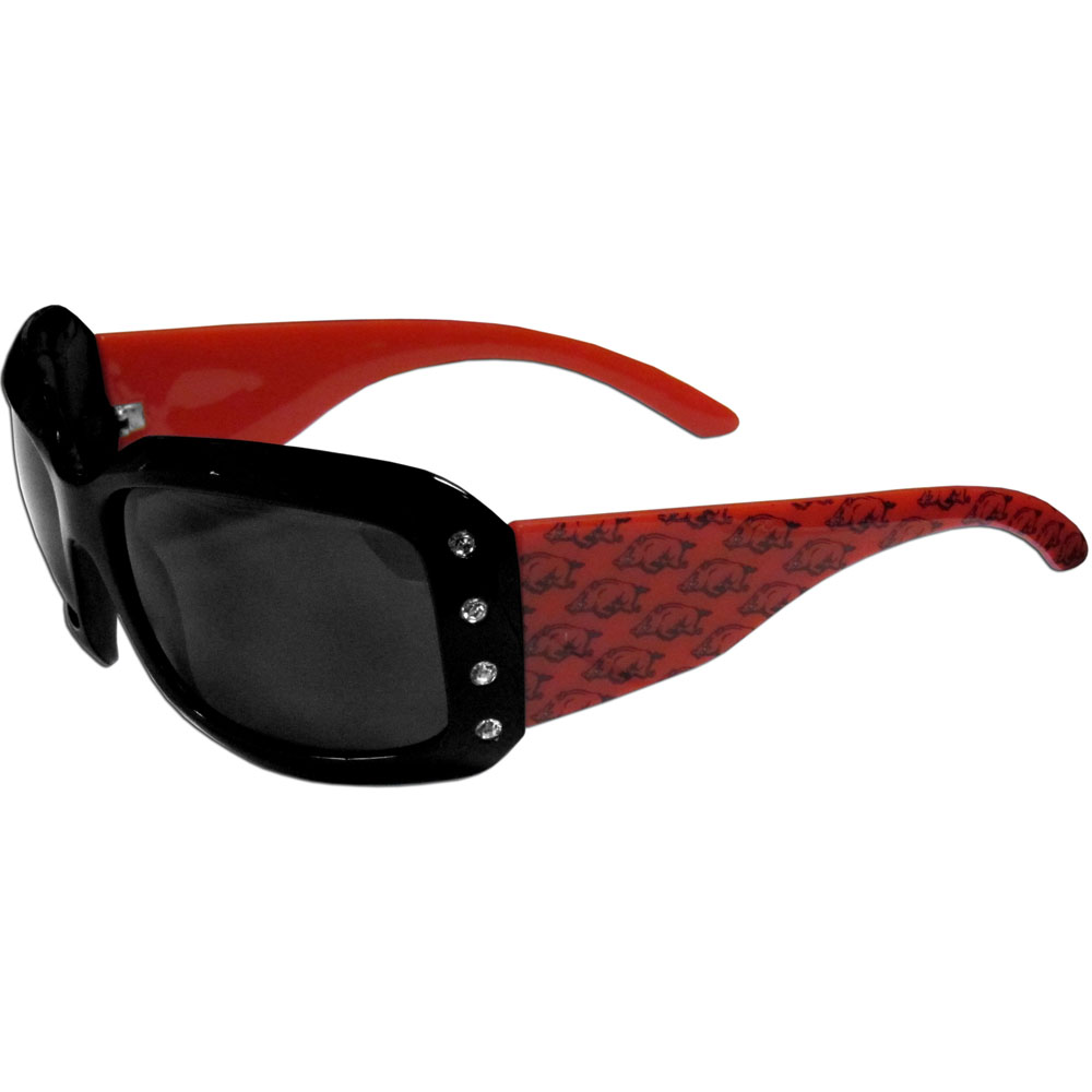 Arkansas Razorbacks Designer Women's Sunglasses - Our designer women's sunglasses have a repeating Arkansas Razorbacks logo design on the team colored arms and rhinestone accents. 100% UVA/UVB protection.