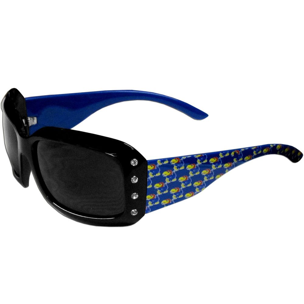 Kansas Jayhawks Designer Women's Sunglasses - Our designer women's sunglasses have a repeating Kansas Jayhawks logo design on the team colored arms and rhinestone accents. 100% UVA/UVB protection.