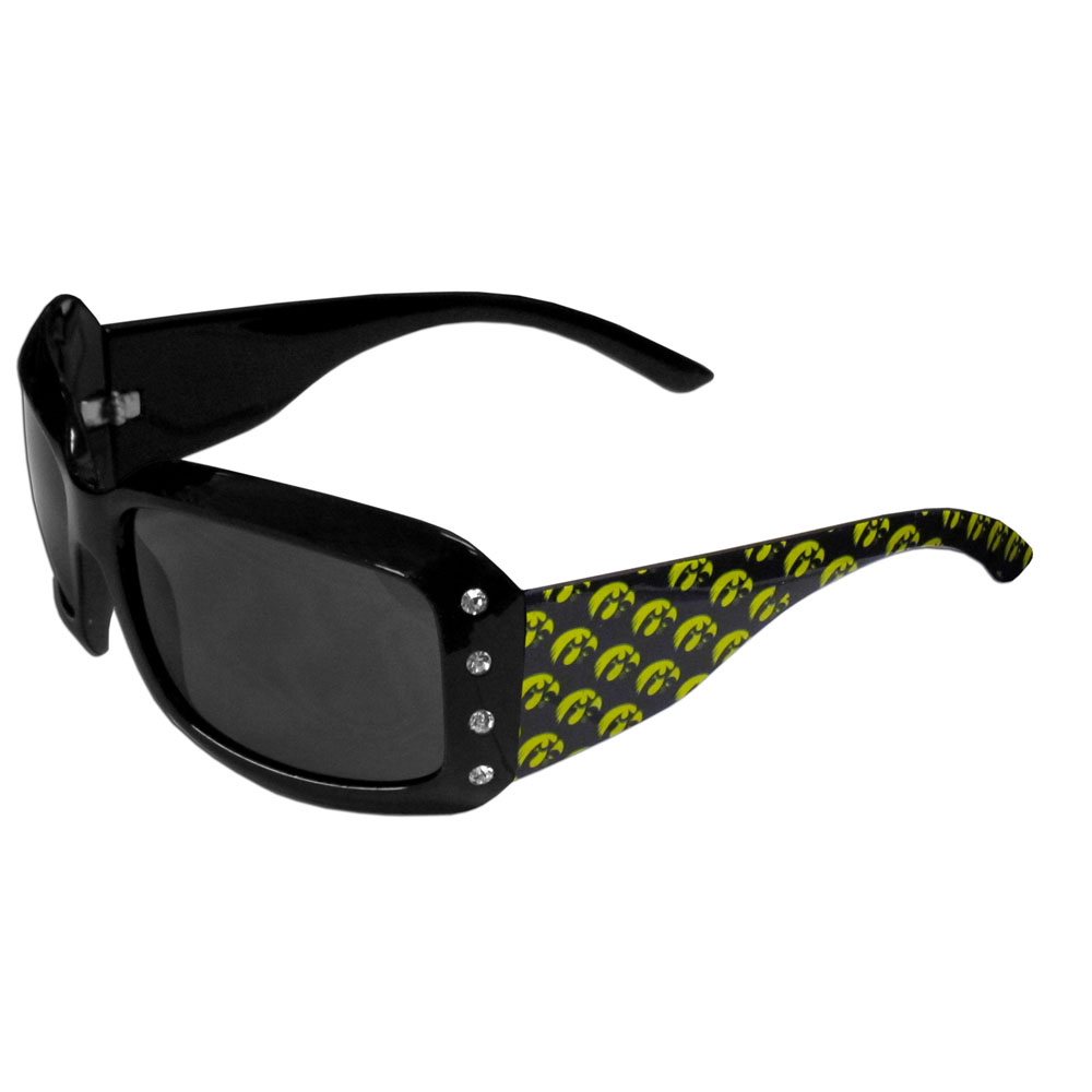 Iowa Hawkeyes Designer Women's Sunglasses - Our designer women's sunglasses have a repeating Iowa Hawkeyes logo design on the team colored arms and rhinestone accents. 100% UVA/UVB protection.