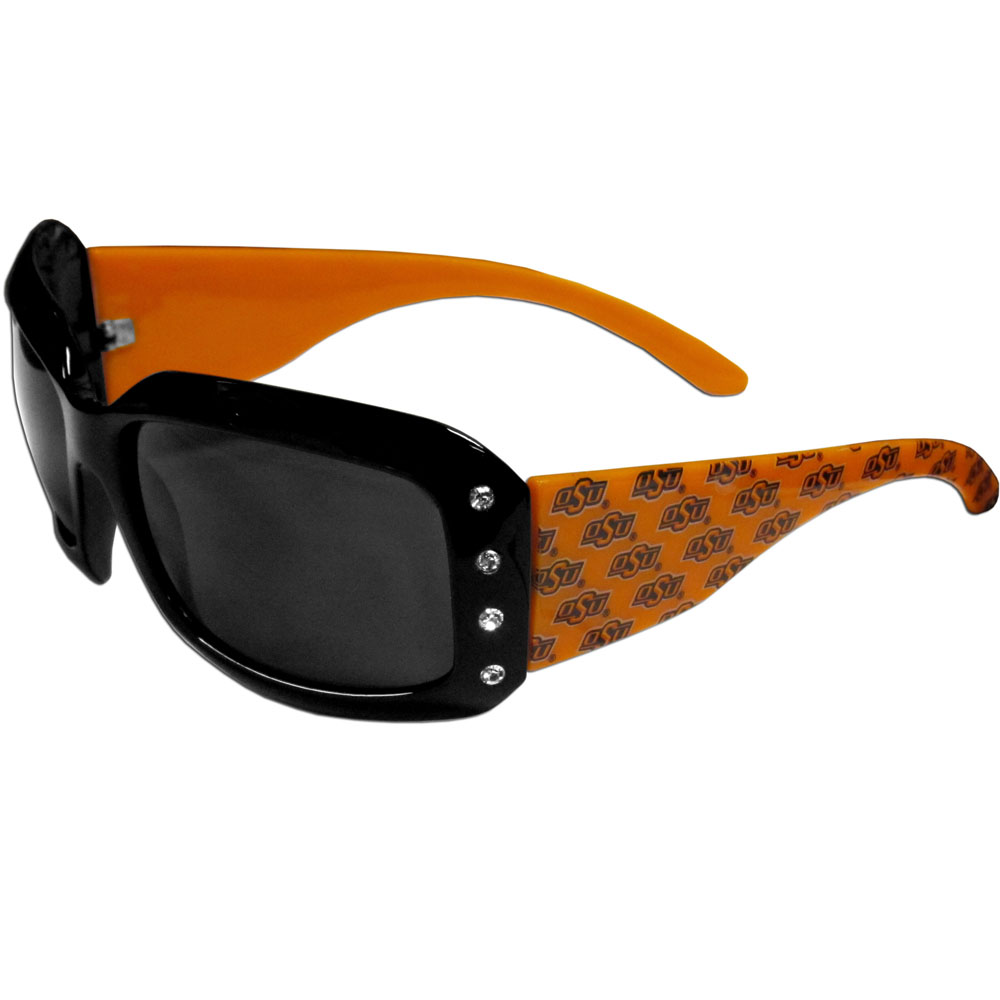 Oklahoma State Cowboys Designer Women's Sunglasses - Our designer women's sunglasses have a repeating Oklahoma State Cowboys logo design on the team colored arms and rhinestone accents. 100% UVA/UVB protection.