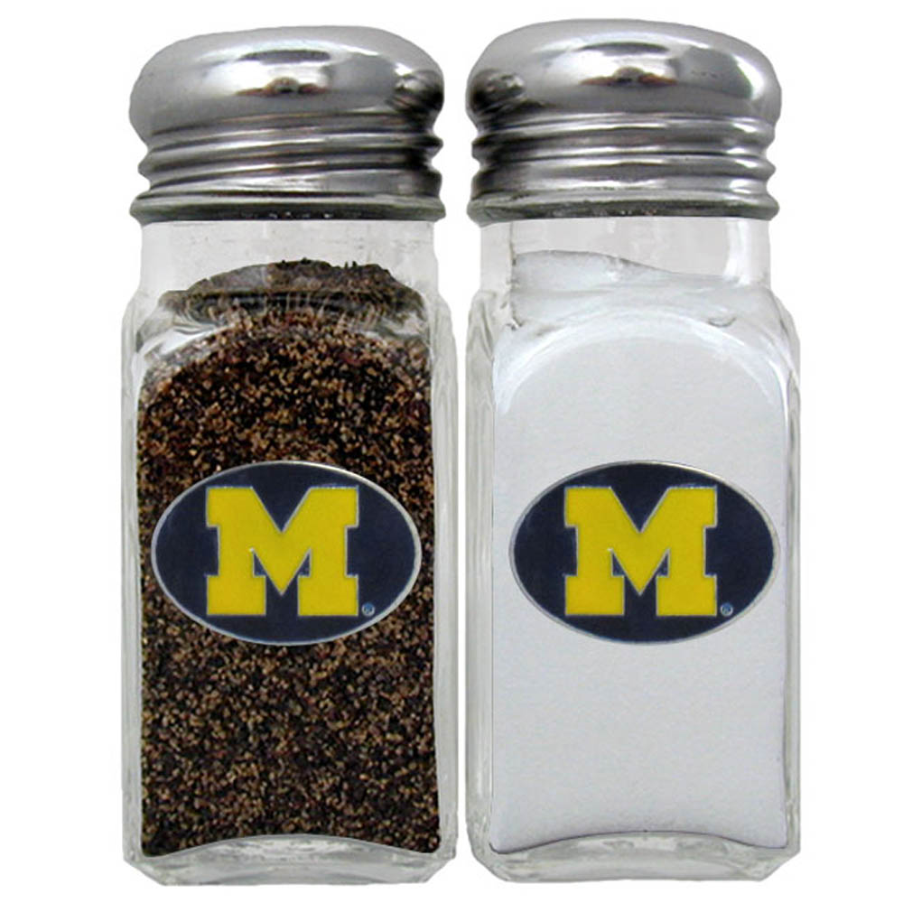 Michigan Wolverines Salt & Pepper Shaker - Our diner replica salt and pepper shakers are the perfect addition to any tailgating or homegating event! The glass shakers have screw on metal tops and feature the Michigan Wolverines logo on each shaker