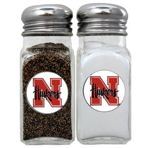 Nebraska Salt & Pepper Shakers - Our diner relica glass salt and pepper shaker sets feature fully cast & enameled Nebraska emblem on each shaker. They are the perfect addition to any outdoor event or indoor get together. Thank you for shopping with CrazedOutSports.com