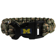 Michigan Wolverines Camo Survivor Bracelet - This functional and fashionable Michigan Wolverines camo survivor bracelet contains 2 individual 300lb test paracord rated cords that are each 5 feet long. The Michigan Wolverines Camo Survivor Bracelet has camo cords can be pulled apart to be used in any number of emergencies and look great while worn. The Michigan Wolverines Camo Survivor Bracelet features a team emblem on the clasp.  Thank you for shopping with CrazedOutSports.com