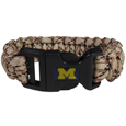 Michigan Wolverines Camo Survivor Bracelet - Michigan Wolverines Camo Survivor Bracelet contains 2 individual 300lb test paracord rated cords that are each 5 feet long. The Michigan Wolverines Camo Survivor Bracelet has camo cords can be pulled apart to be used in any number of emergencies and look great while worn. The Michigan Wolverines Camo Survivor Bracelet features a team emblem on the clasp.  Thank you for shopping with CrazedOutSports.com