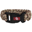 Oklahoma Sooners Camo Survivor Bracelet - Our functional and fashionable Oklahoma Sooners camo survivor bracelets contain 2 individual 300lb test paracord rated cords that are each 5 feet long. The camo cords can be pulled apart to be used in any number of emergencies and look great while worn. The bracelet features a team emblem on the clasp.  Thank you for shopping with CrazedOutSports.com