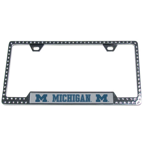Michigan Wolverines Bling License Plate Tag Frame - This collegiate Michigan Wolverines Bling License Plate Tag Frame has the perfect balance of chrome and glitz. The Michigan Wolverines Bling License Plate Tag Frame is framed in crystals with an enameled plate featuring the school's primary logo and name. Thank you for shopping with CrazedOutSports.com
