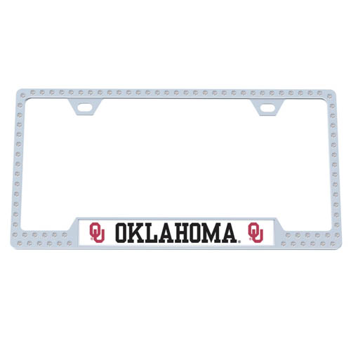 Oklahoma Bling Tag Frame - Our collegiate bling tag frame are the perfect balance of chrome and glitz. The chrome tag frame is framed in crystals with an enameled plate featuring the school's primary logo and name. Thank you for shopping with CrazedOutSports.com