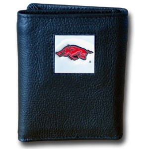 College Tri-fold - Arkansas Razorbacks - Our Arkansas Razorbacks College collectors leather/nylon tri-fold wallet features a sculpted and hand painted team square on a black leather trifold. Includes an ID window, slots for credit cards and clear plastic photo sleeves.  For a sporty feel, the liner of the wallet is high quality nylon. Thank you for shopping with CrazedOutSports.com