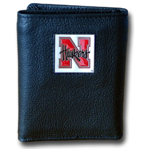 College Tri-fold - Nebraska Cornhuskers - Our College collectors leather/nylon tri-fold wallet features a sculpted and hand painted team square on a black leather trifold. Includes an ID window, slots for credit cards and clear plastic photo sleeves.  For a sporty feel, the liner of the wallet is high quality nylon. Thank you for shopping with CrazedOutSports.com