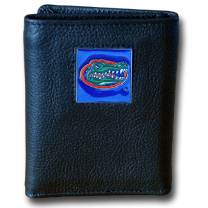 College Tri-fold - Florida Gators - Our College collectors leather/nylon tri-fold wallet features a sculpted and hand painted Florida Gators team square on a black leather trifold. Includes an ID window, slots for credit cards and clear plastic photo sleeves.  For a sporty feel, the liner of the wallet is high quality nylon. Thank you for shopping with CrazedOutSports.com