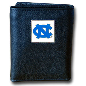 College Tri-fold - N. Carolina Tar Heels - Our College collectors leather/nylon tri-fold wallet features a sculpted and hand painted team square on a black leather trifold. Includes an ID window, slots for credit cards and clear plastic photo sleeves.  For a sporty feel, the liner of the wallet is high quality nylon. Thank you for shopping with CrazedOutSports.com
