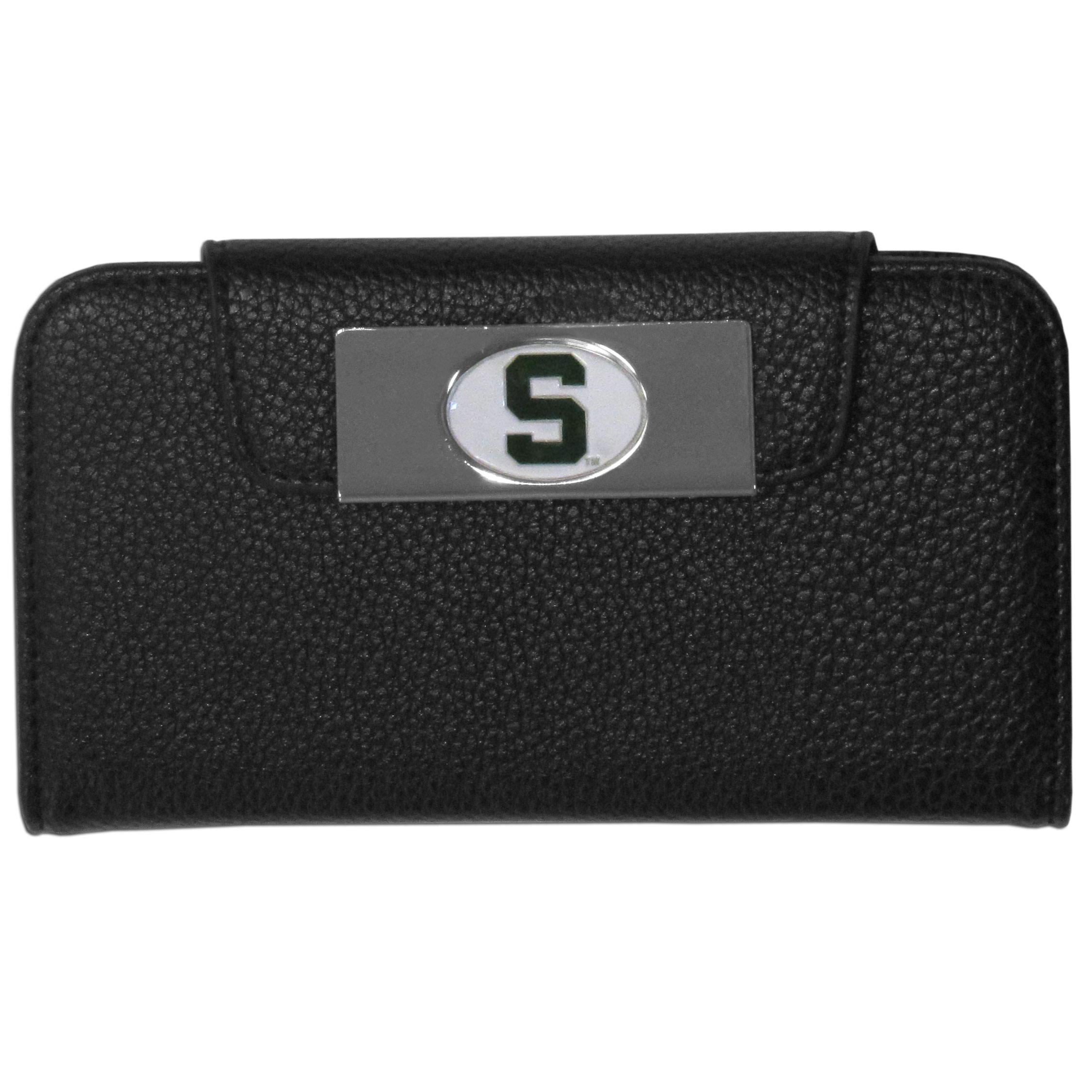 Michigan St. Spartans iPhone 5/5S Wallet Case - This new & wildly popular case is ideal for those who like to travel light! The stylish case has an inner hard shell that securely holds your phone while allowing complete access to the phone's functionality. The flip cover has slots for credit cards, business cards and identification. The magnetic flip cover has a metal Michigan St. Spartans emblem on a high polish chrome backing. Fits the iPhone 5/5S