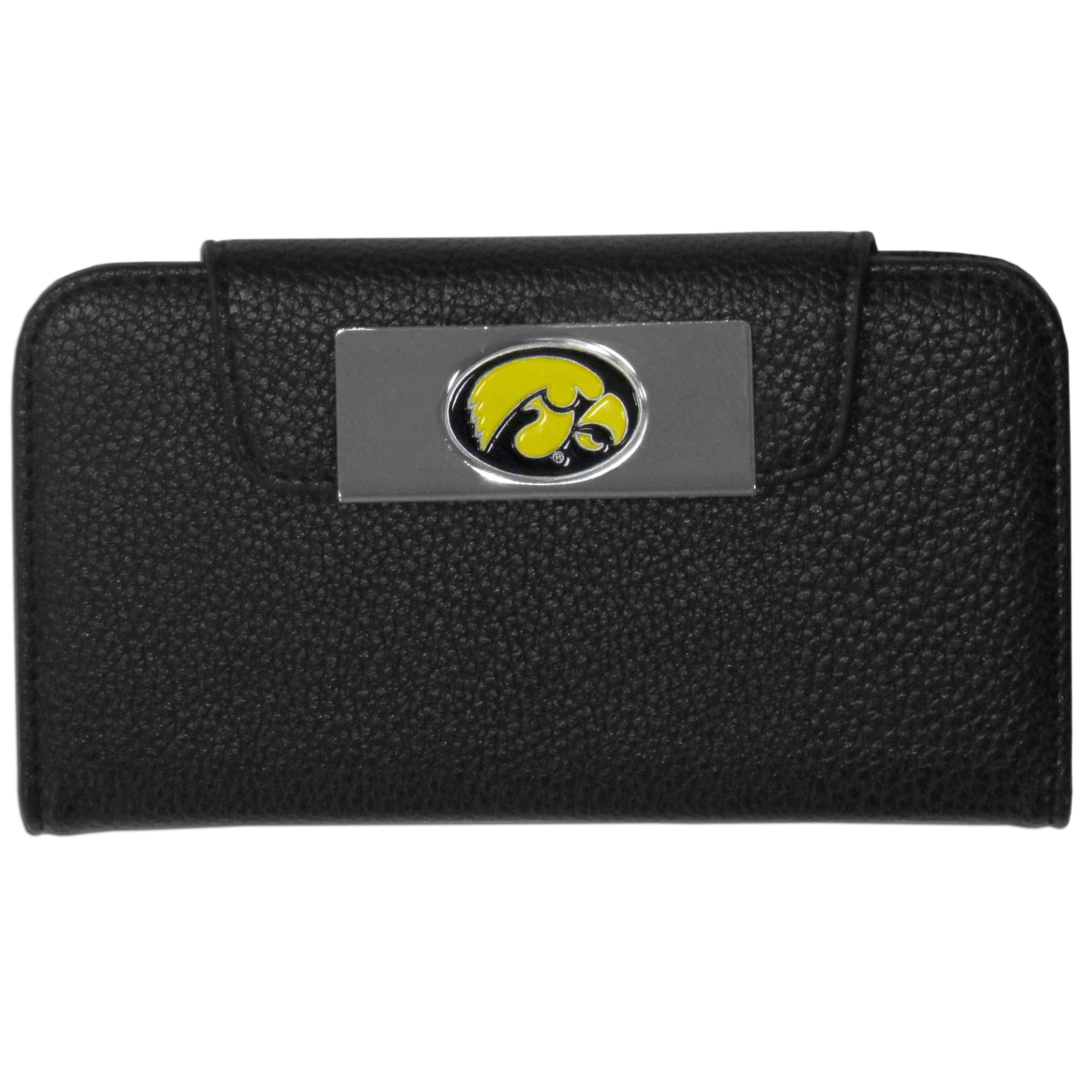 Iowa Hawkeyes iPhone 5/5S Wallet Case - This new & wildly popular case is ideal for those who like to travel light! The stylish case has an inner hard shell that securely holds your phone while allowing complete access to the phone's functionality. The flip cover has slots for credit cards, business cards and identification. The magnetic flip cover has a metal Iowa Hawkeyes emblem on a high polish chrome backing. Fits the iPhone 5/5S