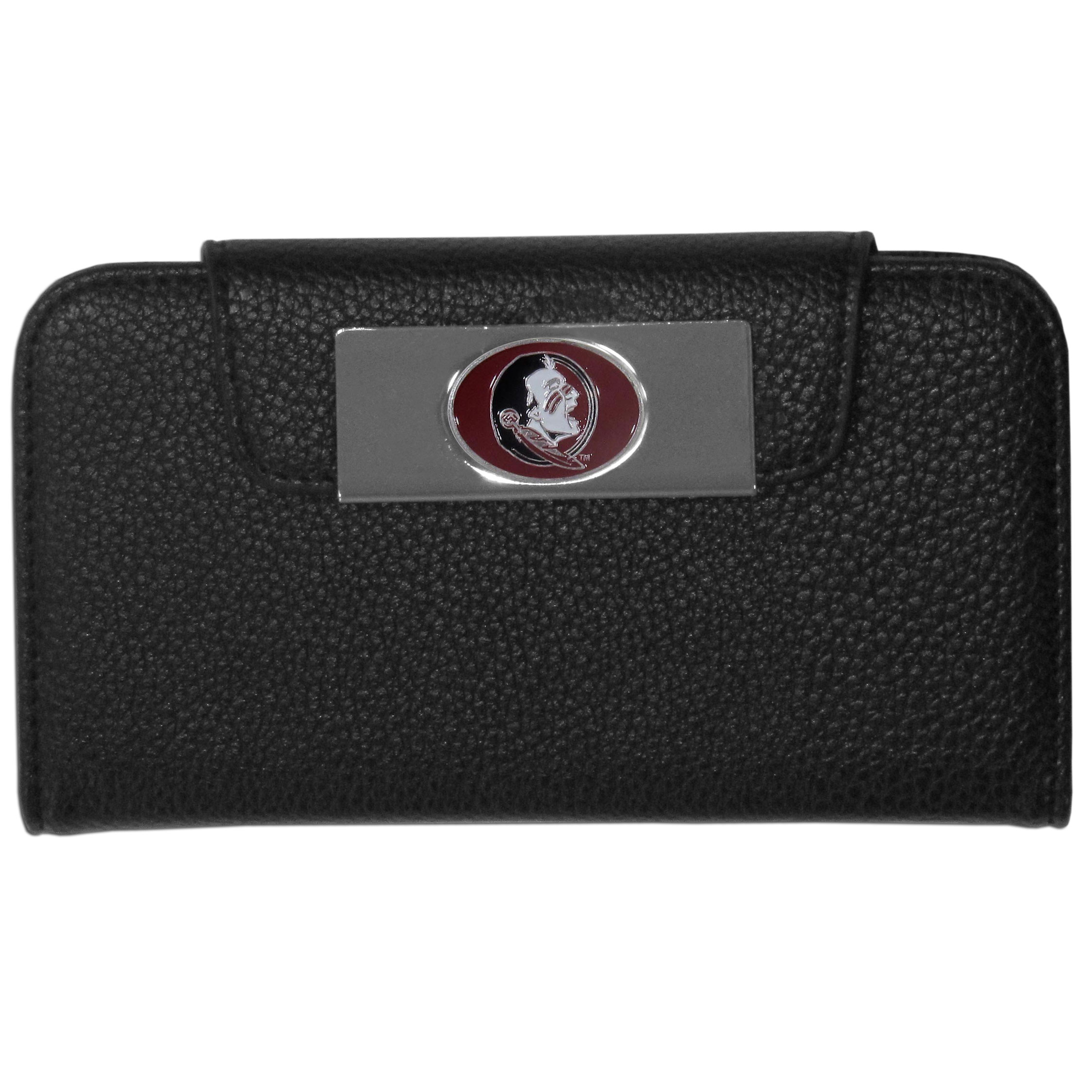 Florida St. Seminoles iPhone 5/5S Wallet Case - This new & wildly popular case is ideal for those who like to travel light! The stylish case has an inner hard shell that securely holds your phone while allowing complete access to the phone's functionality. The flip cover has slots for credit cards, business cards and identification. The magnetic flip cover has a metal Florida St. Seminoles emblem on a high polish chrome backing. Fits the iPhone 5/5S