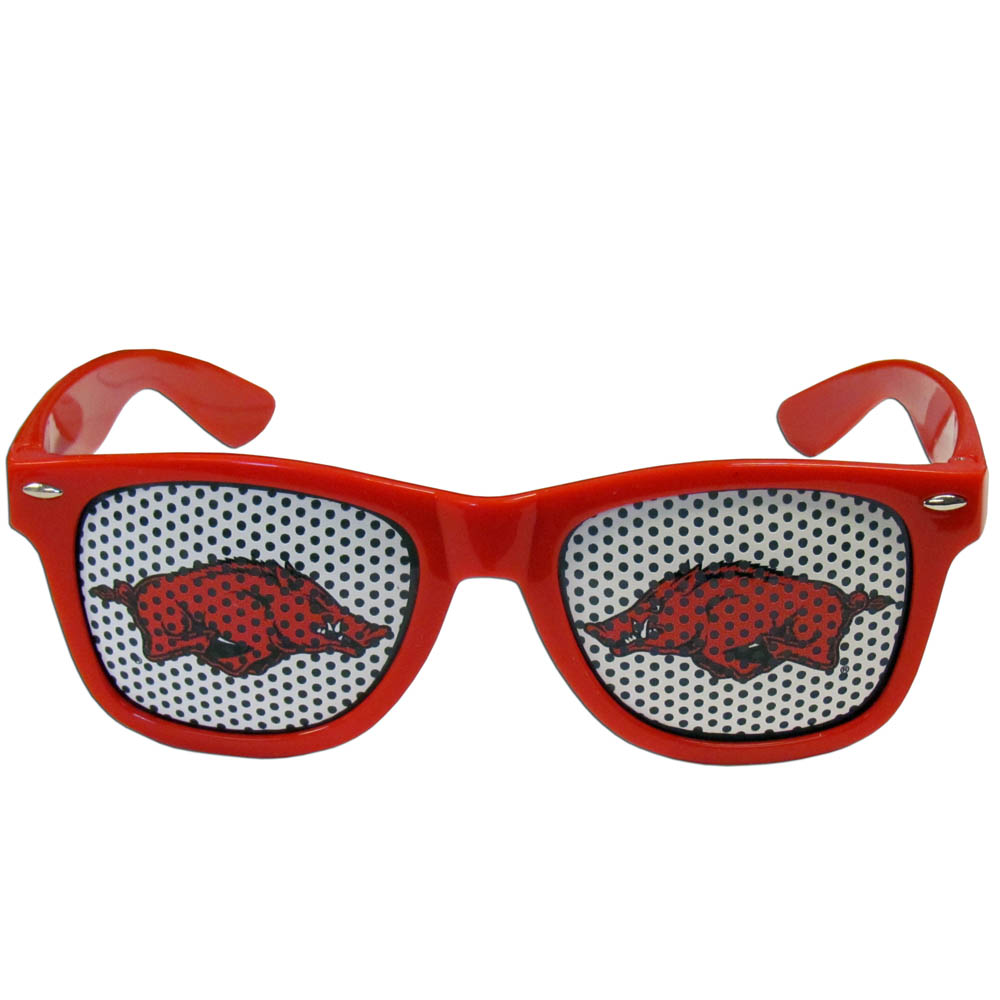 Arkansas Razorbacks Game Day Shades - Our officially licensed game day shades are the perfect accessory for the devoted Arkansas Razorbacks fan! The sunglasses have durable polycarbonate frames with flex hinges for comfort and damage resistance. The lenses feature brightly colored team clings that are perforated for visibility.