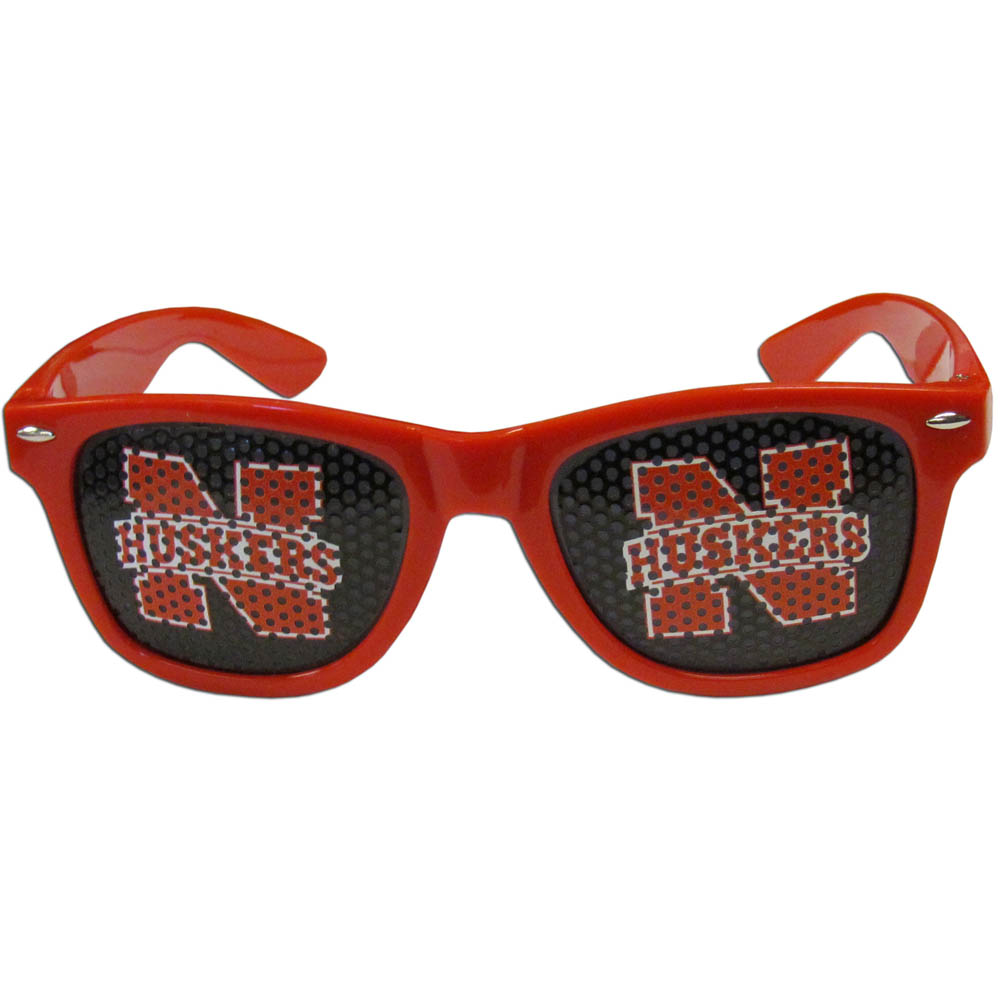 Nebraska Cornhuskers Game Day Shades - Our officially licensed game day shades are the perfect accessory for the devoted Nebraska Cornhuskers fan! The sunglasses have durable polycarbonate frames with flex hinges for comfort and damage resistance. The lenses feature brightly colored team clings that are perforated for visibility.