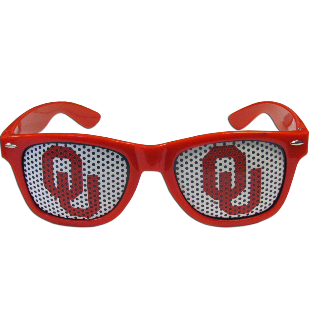 Oklahoma Sooners Game Day Shades - Our officially licensed game day shades are the perfect accessory for the devoted Oklahoma Sooners fan! The sunglasses have durable polycarbonate frames with flex hinges for comfort and damage resistance. The lenses feature brightly colored team clings that are perforated for visibility.