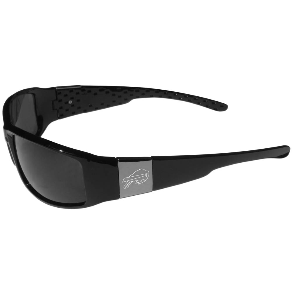 Buffalo Bills Chrome Wrap Sunglasses - Our officially licensed black wrap sunglasses are a sleek and fashionable way to show off your Buffalo Bills pride. The quality frames are accented with chrome shield on each arm that has a laser etched team logo. The frames feature flex hinges for comfort and durability and the lenses have the maximum UVA/UVB protection.