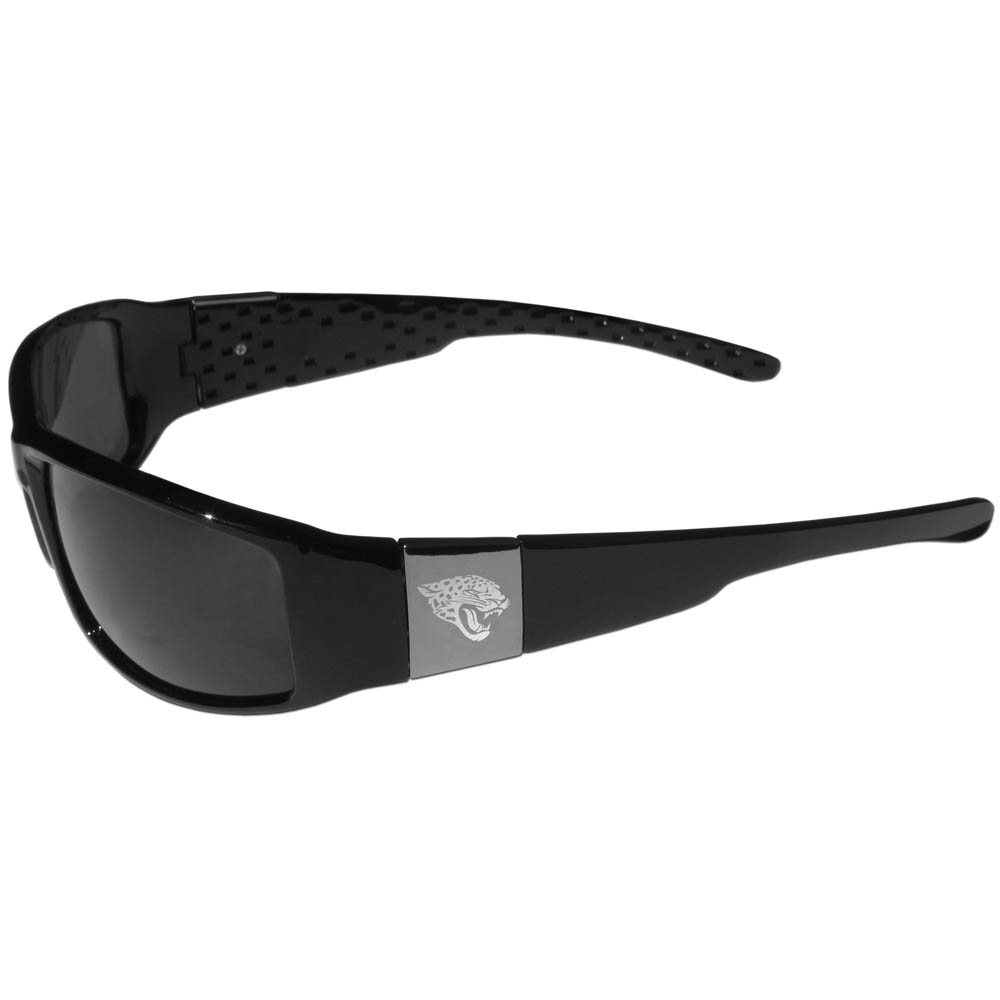 Jacksonville Jaguars Chrome Wrap Sunglasses - Our officially licensed black wrap sunglasses are a sleek and fashionable way to show off your Jacksonville Jaguars pride. The quality frames are accented with chrome shield on each arm that has a laser etched team logo. The frames feature flex hinges for comfort and durability and the lenses have the maximum UVA/UVB protection.