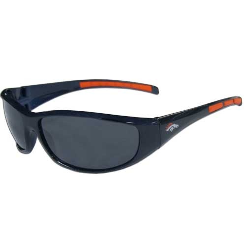 Denver Broncos Wrap Sunglasses  - These sporty looking Denver Broncos Wrap Sunglasses have the Denver Broncos logo screen printed on both sides of the frames. The wrap sunglass arms feature rubber Denver Broncos colored accents. Look great in our Denver Broncos sports memorabilia while rooting for your favorite sports team. Officially licensed NFL product Licensee: Siskiyou Buckle Thank you for visiting CrazedOutSports.com