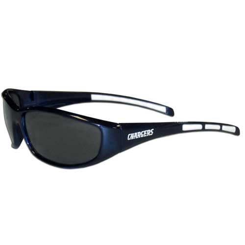 Los Angeles Chargers Wrap Sunglasses - These sporty looking Los Angeles Chargers Wrap Sunglasses have the Los Angeles Chargers logo screen printed on both sides of the frames. The wrap sunglass arms feature rubber Los Angeles Chargers colored accents. Look great in our Los Angeles Chargers sports memorabilia while rooting for your favorite sports team. Officially licensed NFL product Licensee: Siskiyou Buckle .com