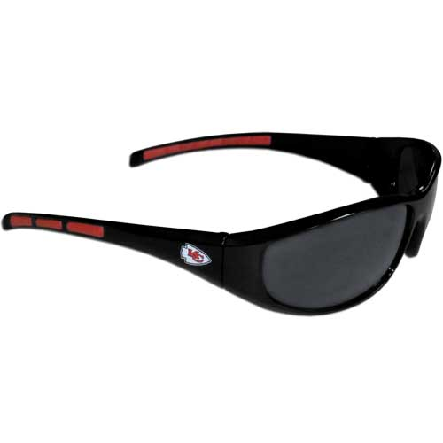 Kansas City Chiefs Wrap Sunglasses - These sporty looking Kansas City Chiefs Wrap Sunglasses have the Kansas City Chiefs logo screen printed on both sides of the frames. The wrap sunglass arms feature rubber Kansas City Chiefs colored accents. Look great in our Kansas City Chiefs sports memorabilia while rooting for your favorite sports team. Officially licensed NFL product Licensee: Siskiyou Buckle Thank you for visiting CrazedOutSports.com