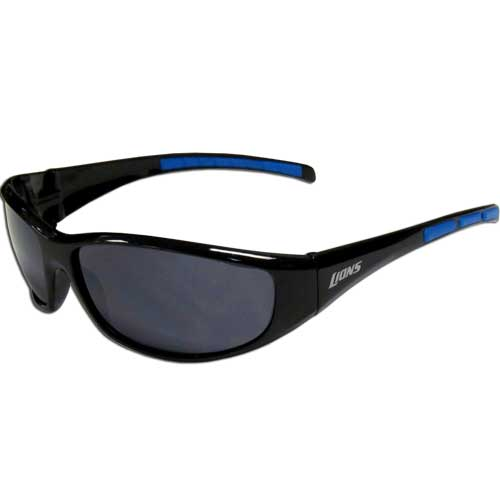 Detroit Lions Wrap Sunglasses - These sporty looking Detroit Lions Wrap Sunglasses have the Detroit Lions logo screen printed on both sides of the frames. The wrap sunglass arms feature rubber Detroit Lions colored accents. Look great in our Detroit Lions sports memorabilia while rooting for your favorite sports team. Officially licensed NFL product Licensee: Siskiyou Buckle .com