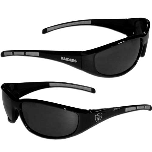 Oakland Raiders Wrap Sunglasses - These sporty looking Oakland Raiders Wrap Sunglasses have the Oakland Raiders logo screen printed on both sides of the frames. The wrap sunglass arms feature rubber Oakland Raiders colored accents. Look great in our Oakland Raiders sports memorabilia while rooting for your favorite sports team. Officially licensed NFL product Licensee: Siskiyou Buckle Thank you for visiting CrazedOutSports.com