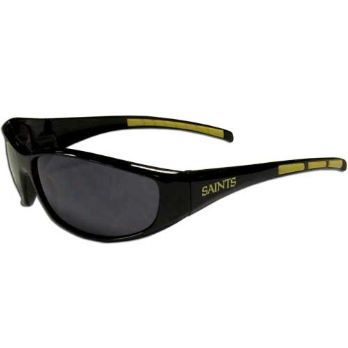 New Orleans Saints Wrap Sunglasses - These sporty looking New Orleans Saints Wrap Sunglasses have the New Orleans Saints logo screen printed on both sides of the frames. The wrap sunglass arms feature rubber New Orleans Saints colored accents. Look great in our New Orleans Saints sports memorabilia while rooting for your favorite sports team. Officially licensed NFL product Licensee: Siskiyou Buckle .com