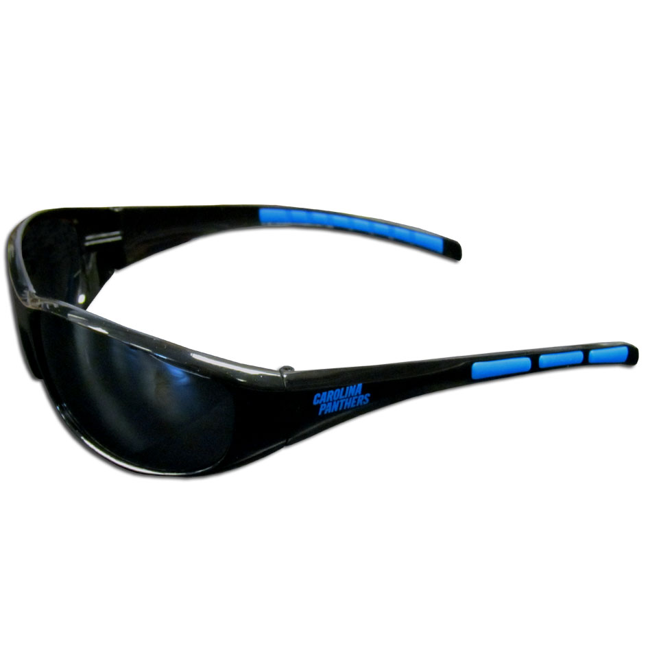 Carolina Panthers Wrap Sunglasses - These sporty looking Carolina Panthers Wrap Sunglasses have the Carolina Panthers logo screen printed on both sides of the frames. The wrap sunglass arms feature rubber Carolina Panthers colored accents. Look great in our Carolina Panthers sports memorabilia while rooting for your favorite sports team. Officially licensed NFL product Licensee: Siskiyou Buckle .com