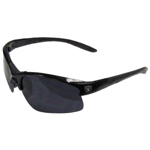 Oakland Raiders Blade Sunglasses - Officially licensed Oakland Raiders blade sunglasses have the Oakland Raiders logo screen printed on both sides of the frames. Look stylish wearing Oakland Raiders sports memorabilia sunglasses with arms that feature rubber colored accents and UV400 protection. Officially licensed NFL product Licensee: Siskiyou Buckle Thank you for visiting CrazedOutSports.com