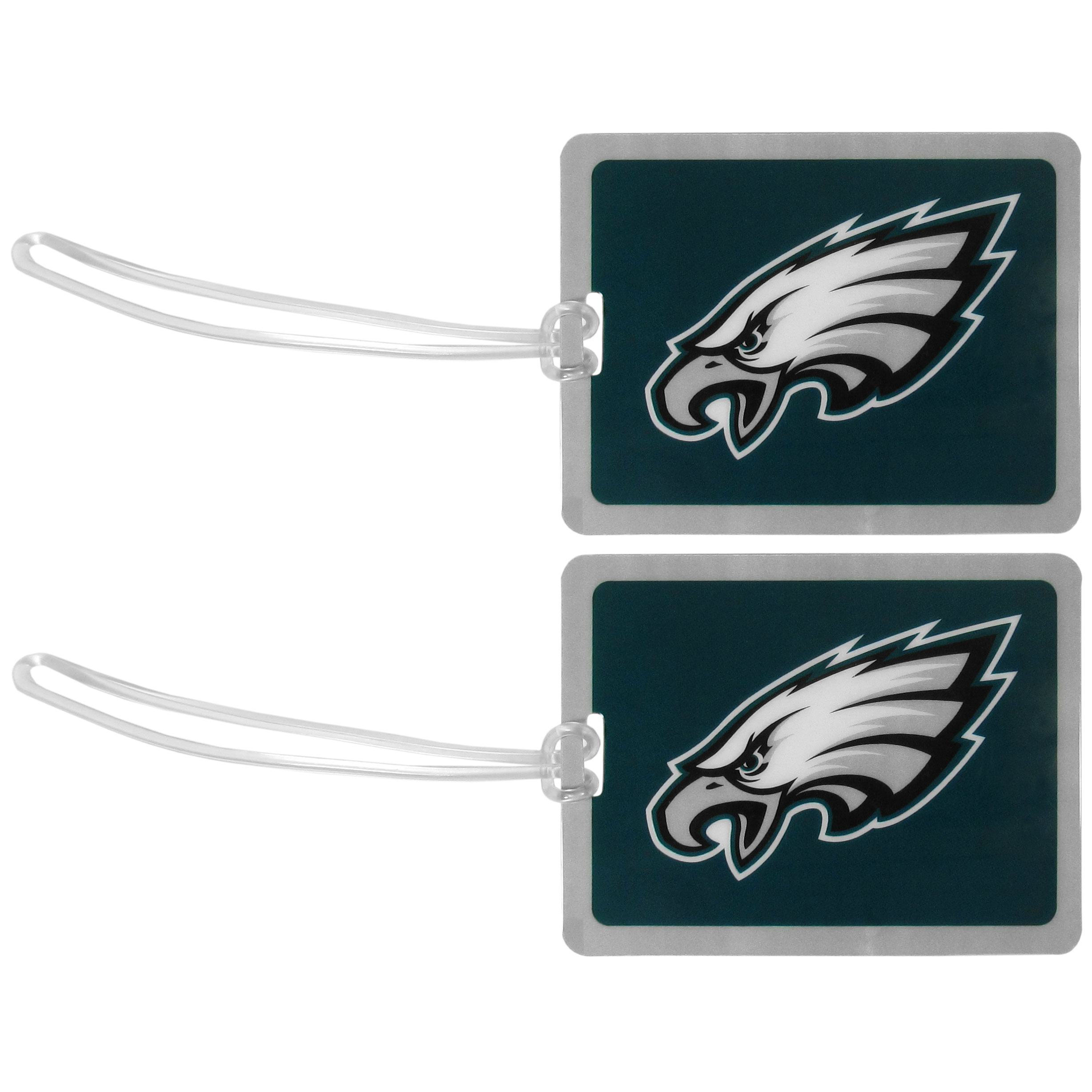 Philadelphia Eagles Vinyl Luggage Tag, 2pk - Tired of trying to spot your suitcase or bag in a sea of luggage? Try our large and colorful Philadelphia Eagles luggage tags. The tag is 4x3 inches and has a 5 inch cord to attach it easily to your bags, backpacks or luggage. The front of the tag features the team logo in a bright, team colored background and you can write you name, address and phone number on the back of the tag.