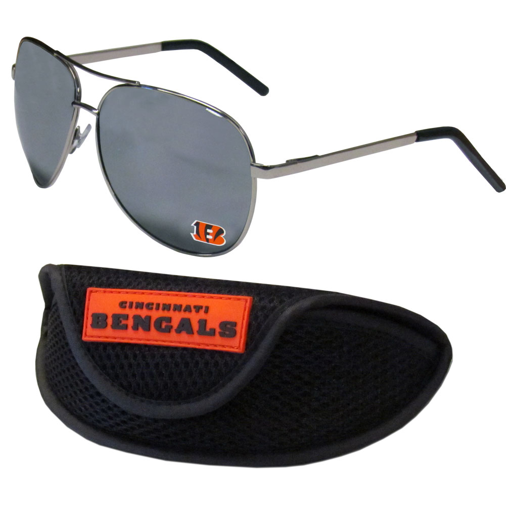 Cincinnati Bengals Aviator Sunglasses and Sports Case - Aviator sunglasses are truly an iconic retro fashion statement that never goes out-of-style. Our Cincinnati Bengals  aviator sunglasses pair this classic look with your love of the game. The iridium coated lenses reduce glare while driving, boating, golfing and their 100% UVA/UVB rating provides you with the maximum UV protection for all your outdoor activities. A millennial favorite, these affordable designer frames are the perfect eyewear accessory for a sports fan that is looking for high-quality at an affordable price. The durable, flex hinged frames are tough enough for hiking and camping or if you prefer sun bathing by the pool or on the beach these shades will really stand the test of time. The sunglasses come with a sporty case which has a large team logo on the lid that will make even the most die-hard fan proud!
