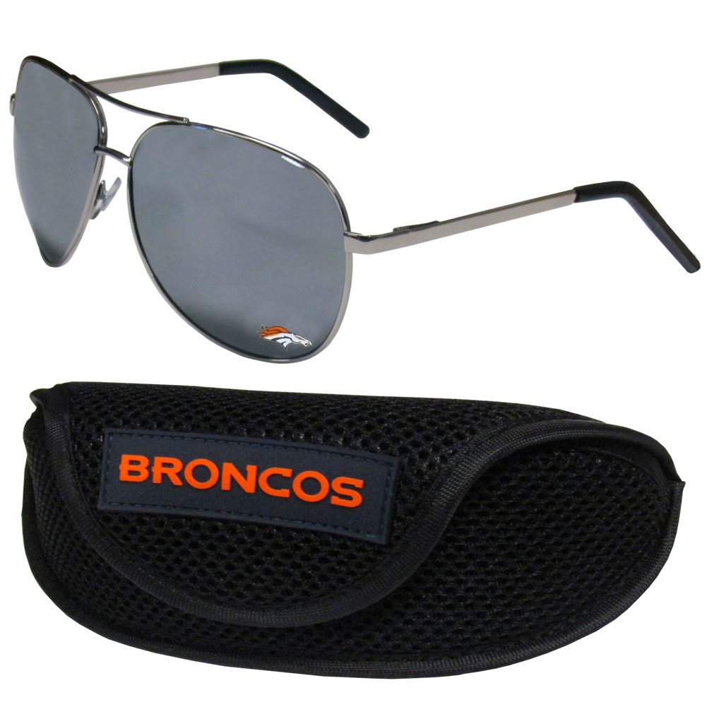 Denver Broncos Aviator Sunglasses and Sports Case - Aviator sunglasses are truly an iconic retro fashion statement that never goes out-of-style. Our Denver Broncos  aviator sunglasses pair this classic look with your love of the game. The iridium coated lenses reduce glare while driving, boating, golfing and their 100% UVA/UVB rating provides you with the maximum UV protection for all your outdoor activities. A millennial favorite, these affordable designer frames are the perfect eyewear accessory for a sports fan that is looking for high-quality at an affordable price. The durable, flex hinged frames are tough enough for hiking and camping or if you prefer sun bathing by the pool or on the beach these shades will really stand the test of time. The sunglasses come with a sporty case which has a large team logo on the lid that will make even the most die-hard fan proud!