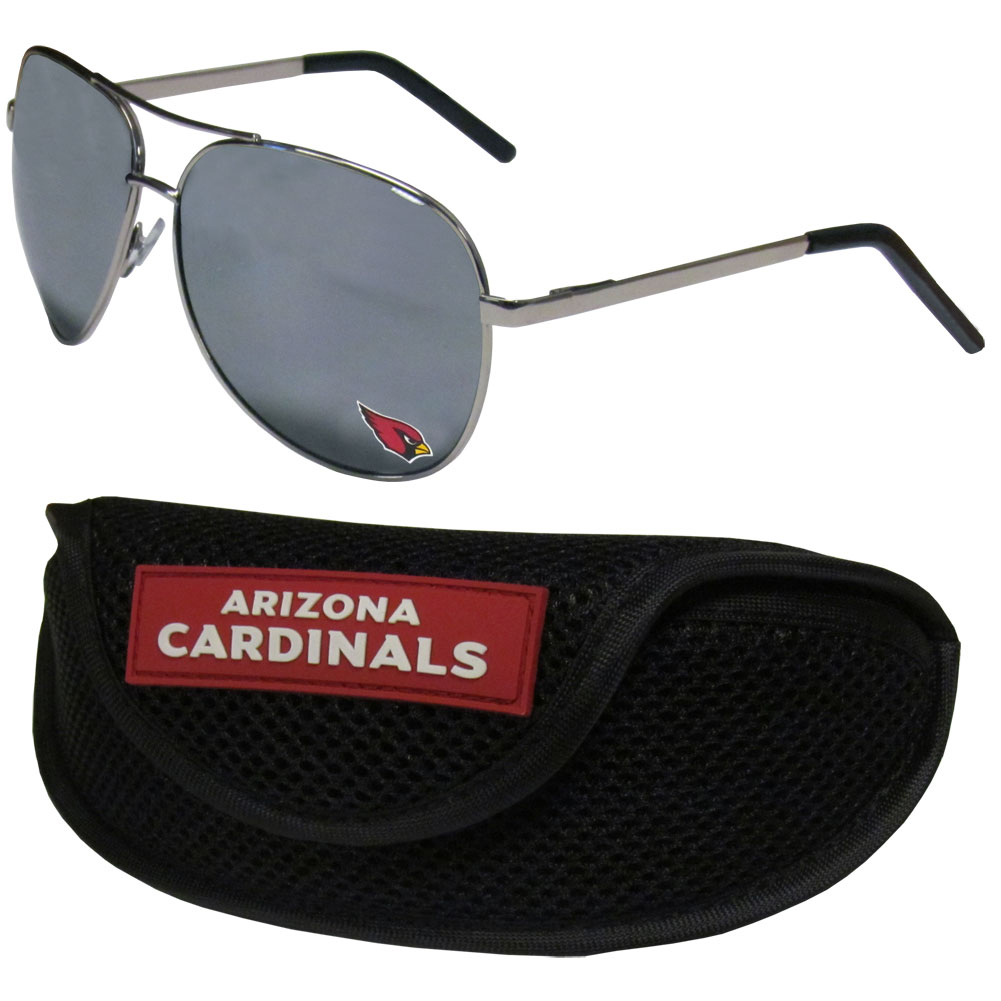 Arizona Cardinals Aviator Sunglasses and Sports Case - Aviator sunglasses are truly an iconic retro fashion statement that never goes out-of-style. Our Arizona Cardinals  aviator sunglasses pair this classic look with your love of the game. The iridium coated lenses reduce glare while driving, boating, golfing and their 100% UVA/UVB rating provides you with the maximum UV protection for all your outdoor activities. A millennial favorite, these affordable designer frames are the perfect eyewear accessory for a sports fan that is looking for high-quality at an affordable price. The durable, flex hinged frames are tough enough for hiking and camping or if you prefer sun bathing by the pool or on the beach these shades will really stand the test of time. The sunglasses come with a sporty case which has a large team logo on the lid that will make even the most die-hard fan proud!