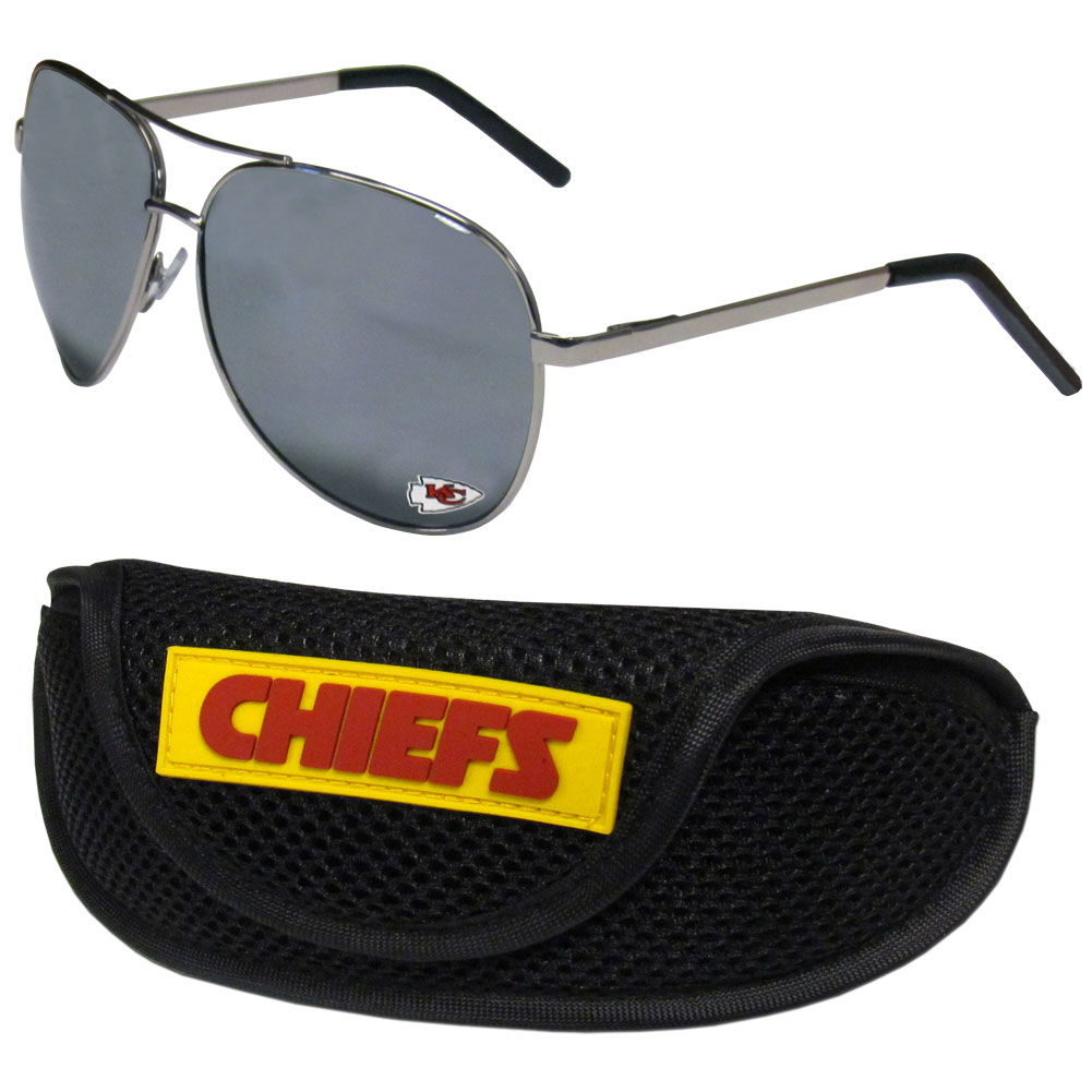 Kansas City Chiefs Aviator Sunglasses and Sports Case - Aviator sunglasses are truly an iconic retro fashion statement that never goes out-of-style. Our Kansas City Chiefs  aviator sunglasses pair this classic look with your love of the game. The iridium coated lenses reduce glare while driving, boating, golfing and their 100% UVA/UVB rating provides you with the maximum UV protection for all your outdoor activities. A millennial favorite, these affordable designer frames are the perfect eyewear accessory for a sports fan that is looking for high-quality at an affordable price. The durable, flex hinged frames are tough enough for hiking and camping or if you prefer sun bathing by the pool or on the beach these shades will really stand the test of time. The sunglasses come with a sporty case which has a large team logo on the lid that will make even the most die-hard fan proud!