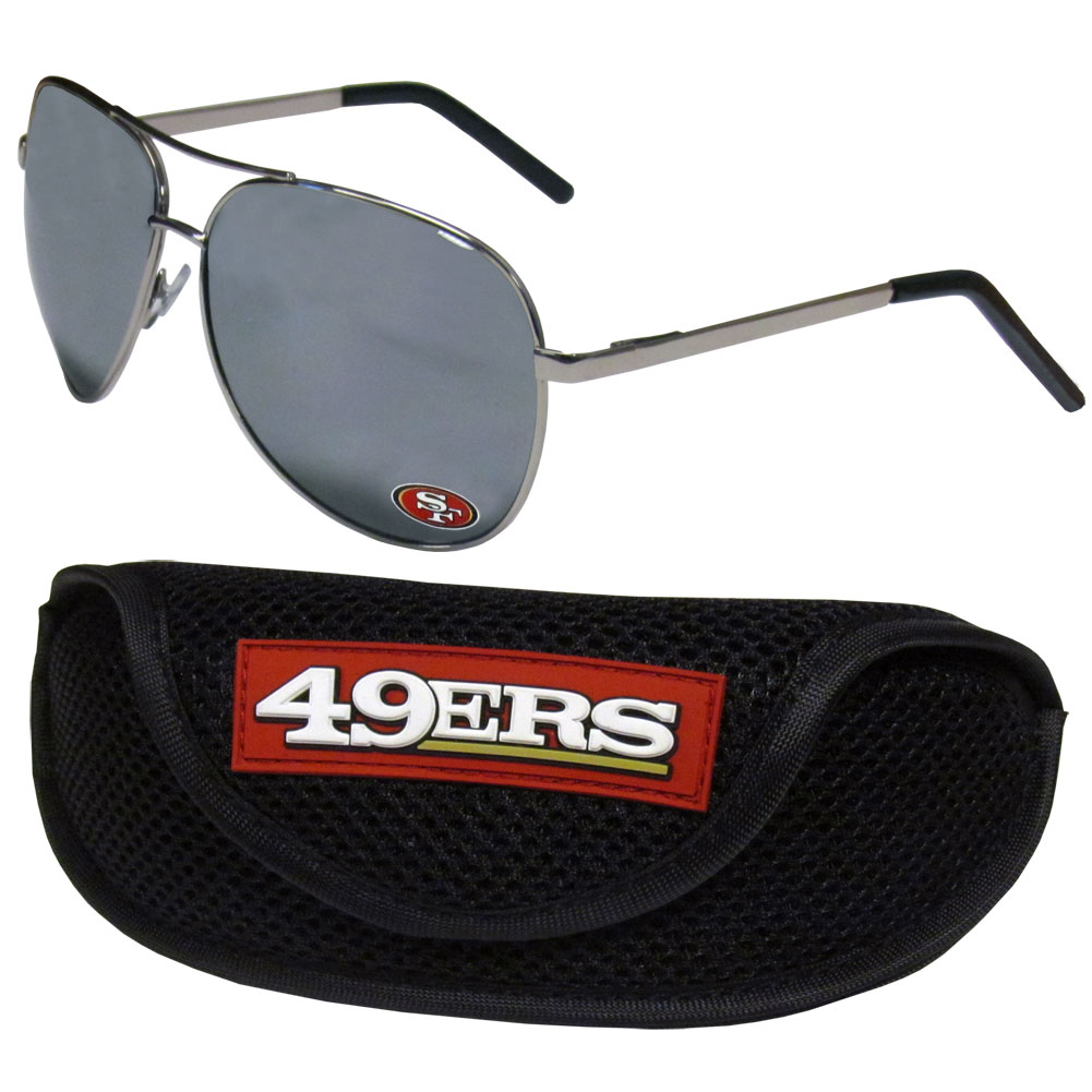 San Francisco 49ers Aviator Sunglasses and Sports Case - Aviator sunglasses are truly an iconic retro fashion statement that never goes out-of-style. Our San Francisco 49ers  aviator sunglasses pair this classic look with your love of the game. The iridium coated lenses reduce glare while driving, boating, golfing and their 100% UVA/UVB rating provides you with the maximum UV protection for all your outdoor activities. A millennial favorite, these affordable designer frames are the perfect eyewear accessory for a sports fan that is looking for high-quality at an affordable price. The durable, flex hinged frames are tough enough for hiking and camping or if you prefer sun bathing by the pool or on the beach these shades will really stand the test of time. The sunglasses come with a sporty case which has a large team logo on the lid that will make even the most die-hard fan proud!