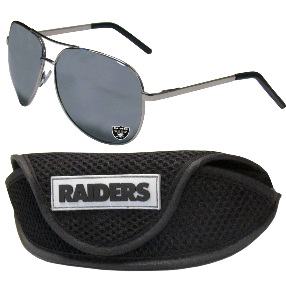 Oakland Raiders Aviator Sunglasses and Sports Case - Aviator sunglasses are truly an iconic retro fashion statement that never goes out-of-style. Our Oakland Raiders  aviator sunglasses pair this classic look with your love of the game. The iridium coated lenses reduce glare while driving, boating, golfing and their 100% UVA/UVB rating provides you with the maximum UV protection for all your outdoor activities. A millennial favorite, these affordable designer frames are the perfect eyewear accessory for a sports fan that is looking for high-quality at an affordable price. The durable, flex hinged frames are tough enough for hiking and camping or if you prefer sun bathing by the pool or on the beach these shades will really stand the test of time. The sunglasses come with a sporty case which has a large team logo on the lid that will make even the most die-hard fan proud!