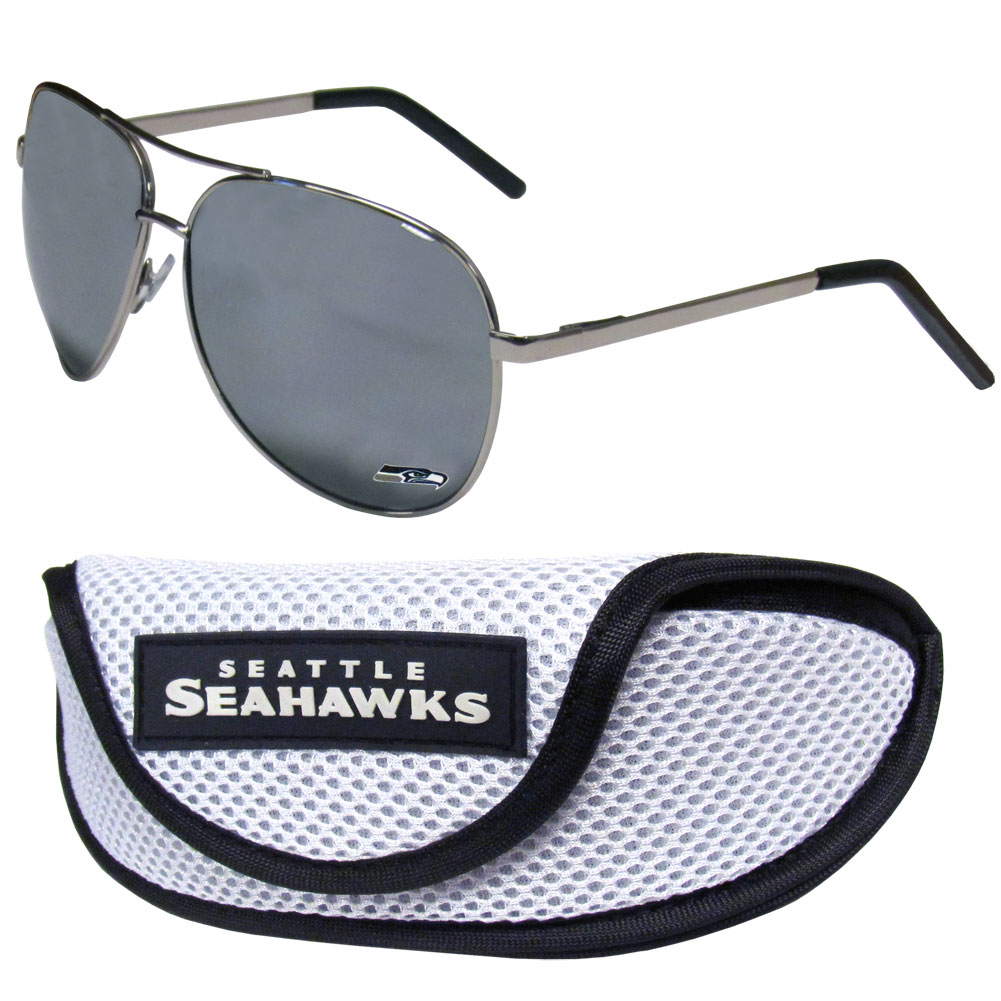 Seattle Seahawks Aviator Sunglasses and Sports Case - Aviator sunglasses are truly an iconic retro fashion statement that never goes out-of-style. Our Seattle Seahawks  aviator sunglasses pair this classic look with your love of the game. The iridium coated lenses reduce glare while driving, boating, golfing and their 100% UVA/UVB rating provides you with the maximum UV protection for all your outdoor activities. A millennial favorite, these affordable designer frames are the perfect eyewear accessory for a sports fan that is looking for high-quality at an affordable price. The durable, flex hinged frames are tough enough for hiking and camping or if you prefer sun bathing by the pool or on the beach these shades will really stand the test of time. The sunglasses come with a sporty case which has a large team logo on the lid that will make even the most die-hard fan proud!
