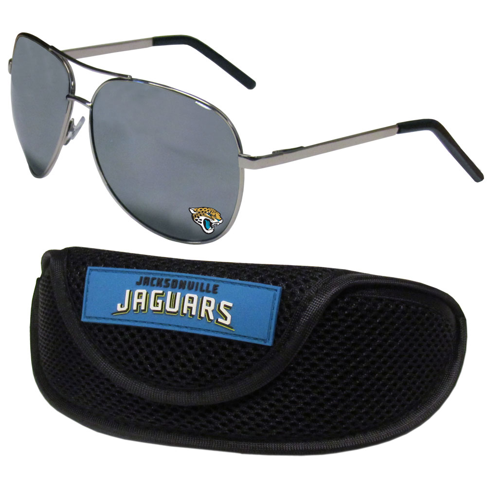 Jacksonville Jaguars Aviator Sunglasses and Sports Case - Aviator sunglasses are truly an iconic retro fashion statement that never goes out-of-style. Our Jacksonville Jaguars  aviator sunglasses pair this classic look with your love of the game. The iridium coated lenses reduce glare while driving, boating, golfing and their 100% UVA/UVB rating provides you with the maximum UV protection for all your outdoor activities. A millennial favorite, these affordable designer frames are the perfect eyewear accessory for a sports fan that is looking for high-quality at an affordable price. The durable, flex hinged frames are tough enough for hiking and camping or if you prefer sun bathing by the pool or on the beach these shades will really stand the test of time. The sunglasses come with a sporty case which has a large team logo on the lid that will make even the most die-hard fan proud!