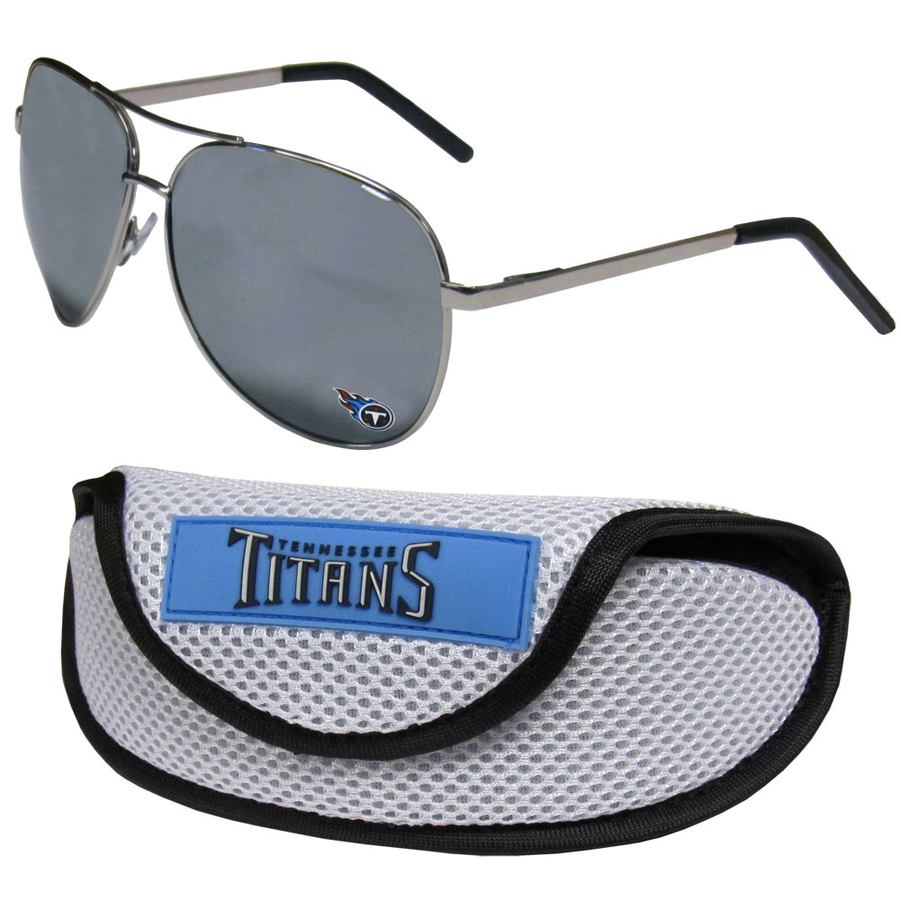 Tennessee Titans Aviator Sunglasses and Sports Case - Aviator sunglasses are truly an iconic retro fashion statement that never goes out-of-style. Our Tennessee Titans  aviator sunglasses pair this classic look with your love of the game. The iridium coated lenses reduce glare while driving, boating, golfing and their 100% UVA/UVB rating provides you with the maximum UV protection for all your outdoor activities. A millennial favorite, these affordable designer frames are the perfect eyewear accessory for a sports fan that is looking for high-quality at an affordable price. The durable, flex hinged frames are tough enough for hiking and camping or if you prefer sun bathing by the pool or on the beach these shades will really stand the test of time. The sunglasses come with a sporty case which has a large team logo on the lid that will make even the most die-hard fan proud!