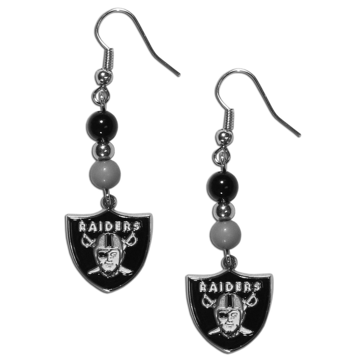 Oakland Raiders Fan Bead Dangle Earrings - Love your team, show it off with our Oakland Raiders bead dangle earrings! These super cute earrings hang approximately 2 inches and features 2 team colored beads and a high polish team charm. A must have for game day!