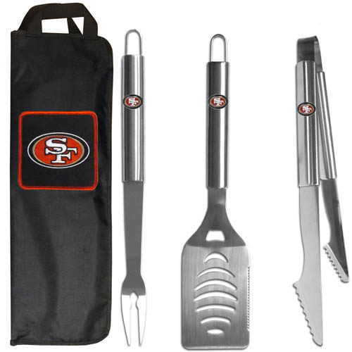 San Francisco 49ers BBQ Set w/Bag - Our San Francisco 49ers stainless steel 3 pc BBQ tool set includes a large spatula with built in bottle opener, heavy duty tongs, and large fork. All the tools feature a team logo on the handle. The set comes with a durable canvas bag that has a chrome accented team logo.  Officially licensed NFL product Licensee: Siskiyou Buckle .com