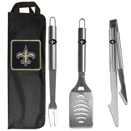 New Orleans Saints BBQ Set w/Bag - Our New Orleans Saints stainless steel 3 pc BBQ tool set includes a large spatula with built in bottle opener, heavy duty tongs, and large fork. All the tools feature a team logo on the handle. The set comes with a durable canvas bag that has a chrome accented team logo.  Officially licensed NFL product Licensee: Siskiyou Buckle Thank you for visiting CrazedOutSports.com
