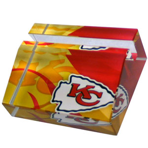 Kansas City Chiefs Business Cardholder - Our Kansas City Chiefs crystal business cardholder is a great way to dress up your desk. The heavy duty cardholder weighs over a pound and is cut from water clear glass and features crisp team graphics that reflect off of the beveled edges of the cardholders to create a striking 3D effect from any angle. Officially licensed NFL product Licensee: Siskiyou Buckle Thank you for visiting CrazedOutSports.com