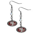 San Francisco 49ers Crystal Dangle Earrings - Our NFL crystal dangle earrings are the perfect accessory for your game day outfit! The earrings are approximately 1.5 inches long and feature an iridescent crystal bead and nickel free chrome San Francisco 49ers charm on nickel free, hypoallergenic fishhook posts. Officially licensed NFL product Licensee: Siskiyou Buckle .com