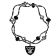 Oakland Raiders Crystal Bead Bracelet - Officially licensed crystal bead bracelet with team colored crystal separated with chrome helix beads. The bracelet features a Oakland Raiders charm with exceptional detail.