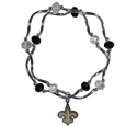 New Orleans Saints Crystal Bead Bracelet - Officially licensed crystal bead bracelet with team colored crystal separated with chrome helix beads. The bracelet features a New Orleans Saints charm with exceptional detail.