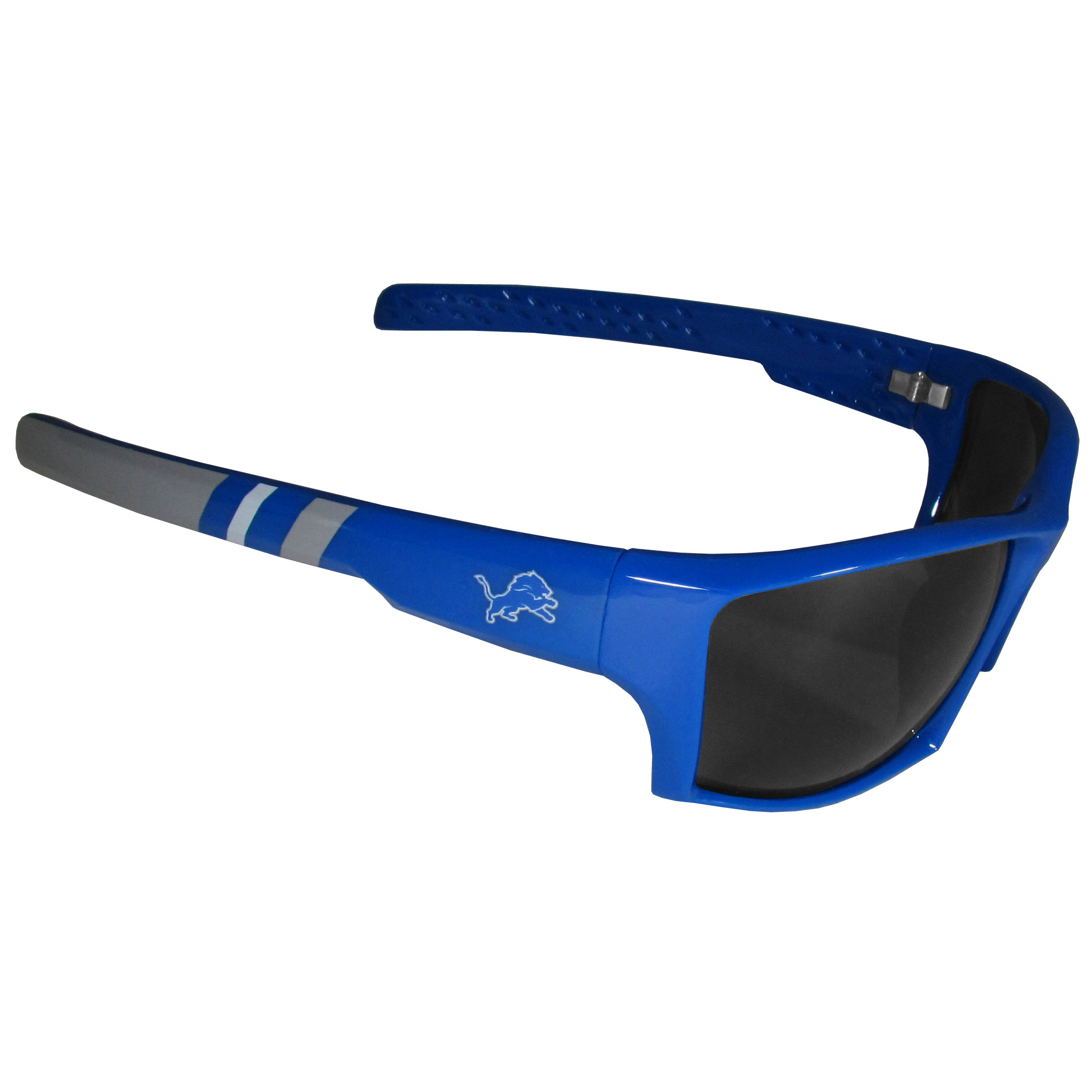 Detroit Lions Edge Wrap Sunglasses - Be an icon of edgy style while you're in the stadium cheering your Detroit Lions to victory with our polarized wrap sunglasses that feature 100% UVA/UVB rating for maximum UV protection. The light-weight frames are built to last with flex hinges for comfort and durability which make them perfect for driving or just lounging by the pool. The colorful rubber grips on the arms of these fashionable sunglasses make them perfect for someone with an active lifestyle. Whether you are hiking, fishing, boating, running on the beach, golfing or playing your favorite sport these designer frames will set you apart. Our edge wrap sunglasses are true quality eyewear at an affordable price. The wrap style frames come with team colored stripes and team logos so you can show off your die-hard team pride while protecting your eyes from those bright sun rays.